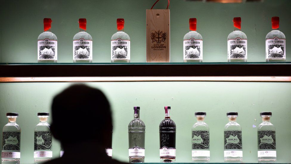 Bottles of gin are pictured in the City Of London Distillery in London on October 16, 2015. The quintessentially British drink of gin is shaking off its grandmotherly image to enjoy a revival led by the capital London, which has seen a boom in distilleries and gin-dedicated bars