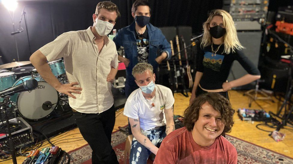 Wolf Alice and, crouched on the floor a safe distance away, our reporter Will