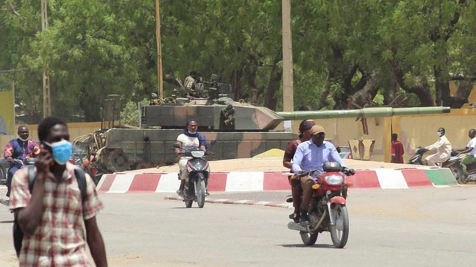 A Russian made T-55 tank in seen stationed at a roundabout in the city of N'Djamena, Chad, on April 19, 2021