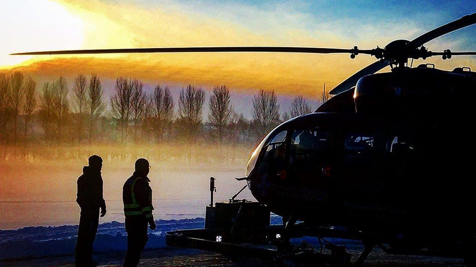 Wales Air Ambulance and crew at sunrise