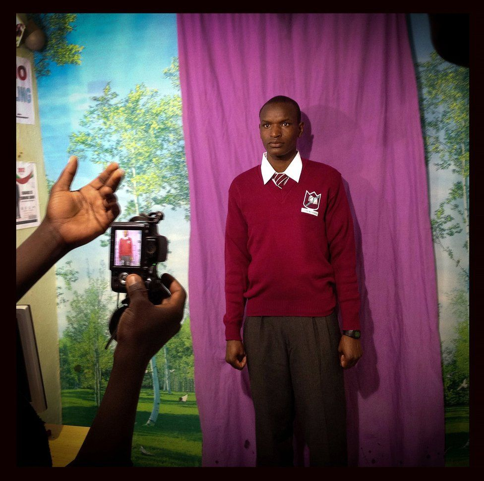 A student poses for a school photo