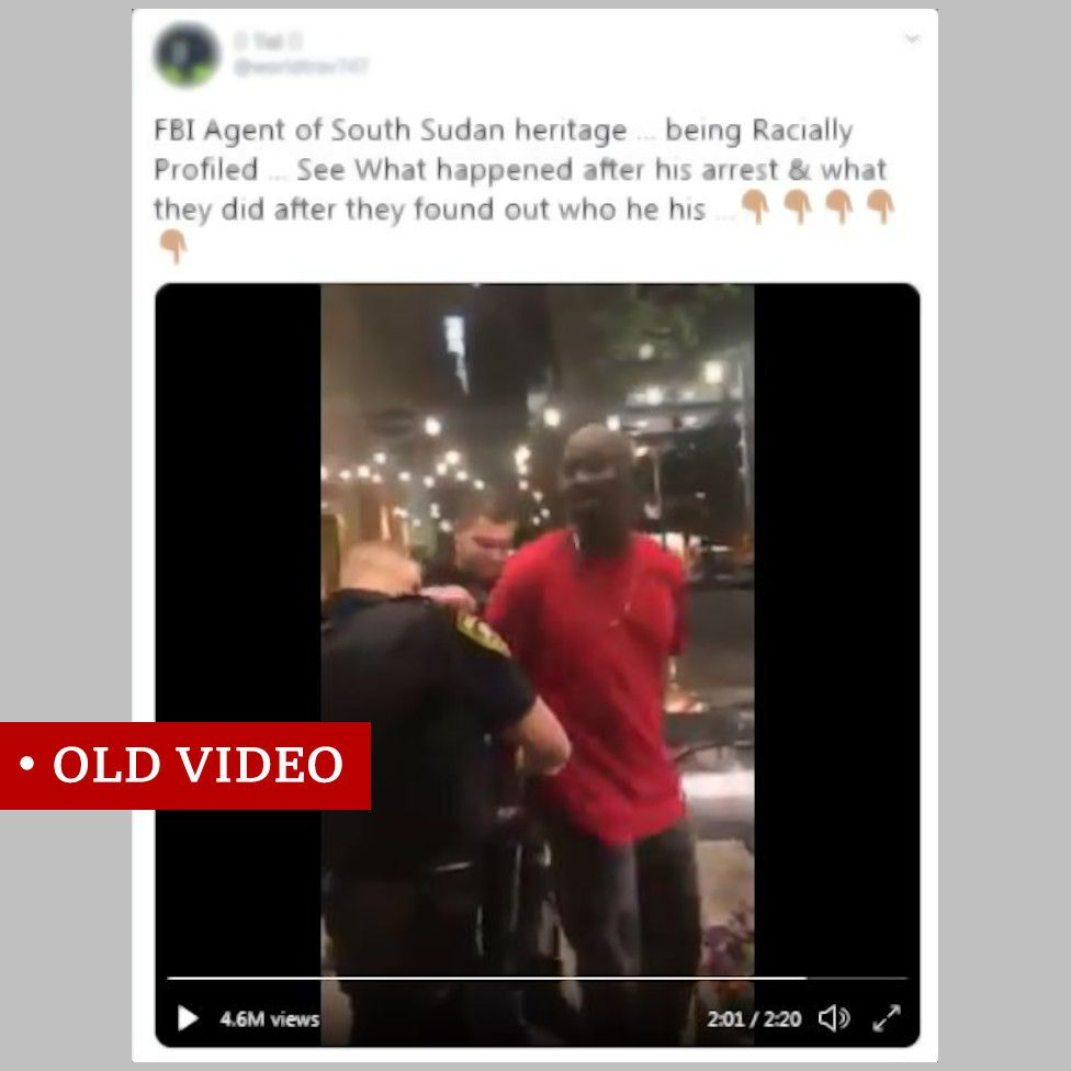 """Screenshot of video showing two white policemen arresting a black man. The Twitter post above it says: """"FBI Agent of South Sudan heritage ... being Racially Profiled ... See What happened after his arrest & what they did after they found out who he his ..."""""""