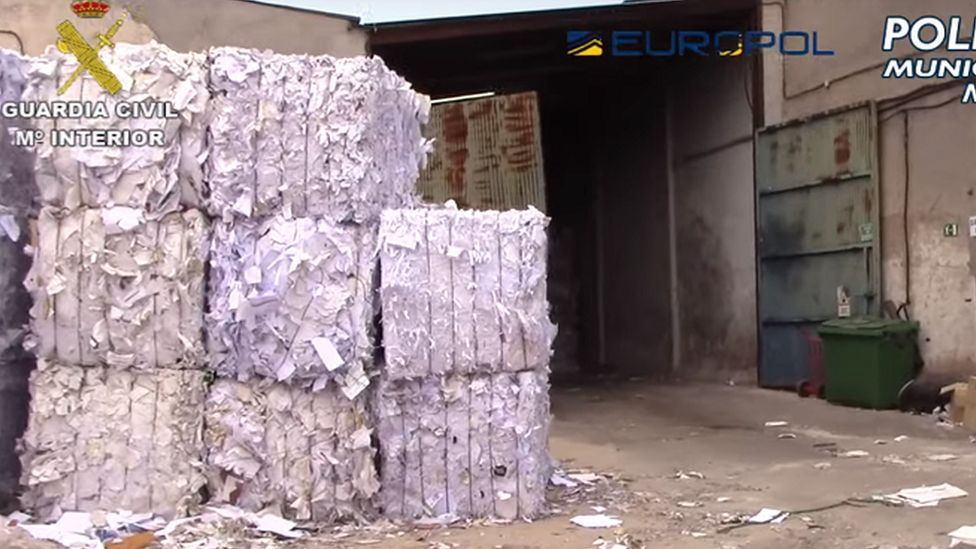 A picture of stacks of paper outside a waste processing plant in Madrid
