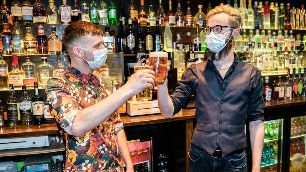 Barr staff celebrate in the Showtime Bar in Huddersfield, West Yorkshire, as indoor hospitality and entertainment venues reopen