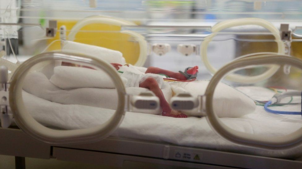 One of the nonuplets is seen in an incubator at the private clinic of Ain Borja, in Casablanca, Morocco May 5, 2021
