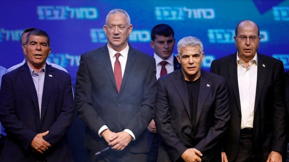 Blue and White party leader Benny Gantz (2nd L) with co-leaders Gaby Ashkenazi (L), Yair Lapid (2nd R) and Moshe Yaalon (R) at an election night rally in Tel Aviv on 18 September 2019 Reuters