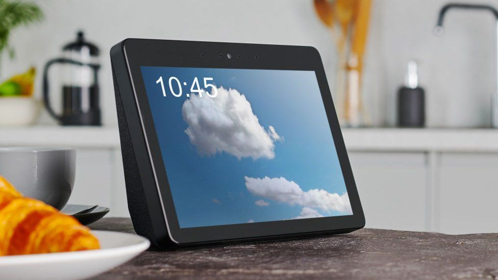 Amazon's Echo Show, is displayed on a kitchen counter with a cloud on its display