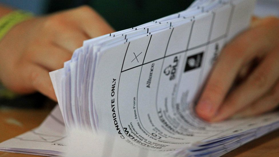 Ballot papers are counted during an election count