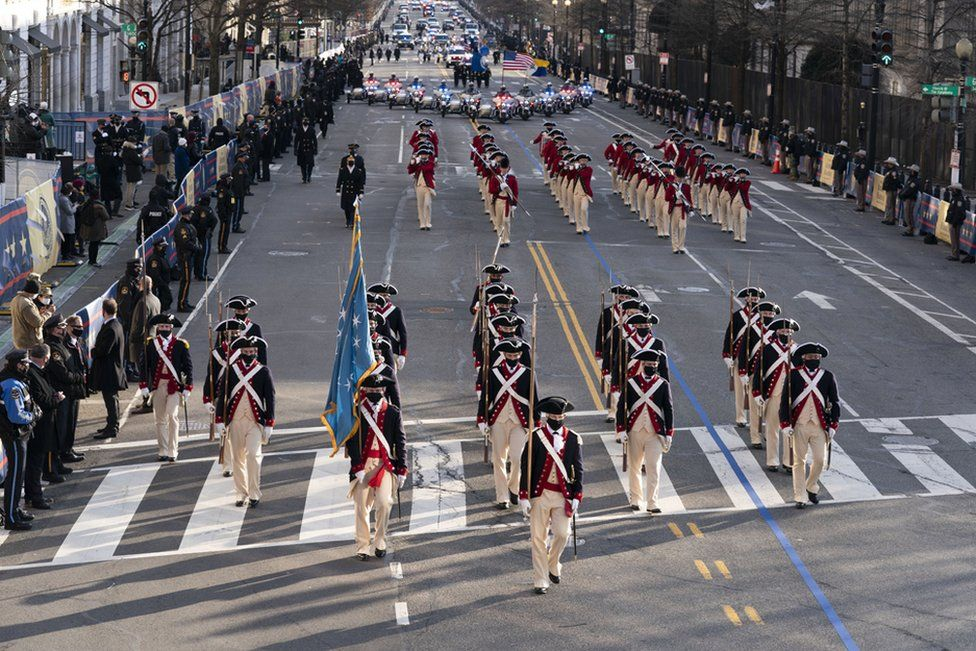 Members of the military march on 15th Street towards the White House during a Presidential Escort of US President Joe Biden's limousine to the White House, in Washington, DC, USA, 20 January 2021.