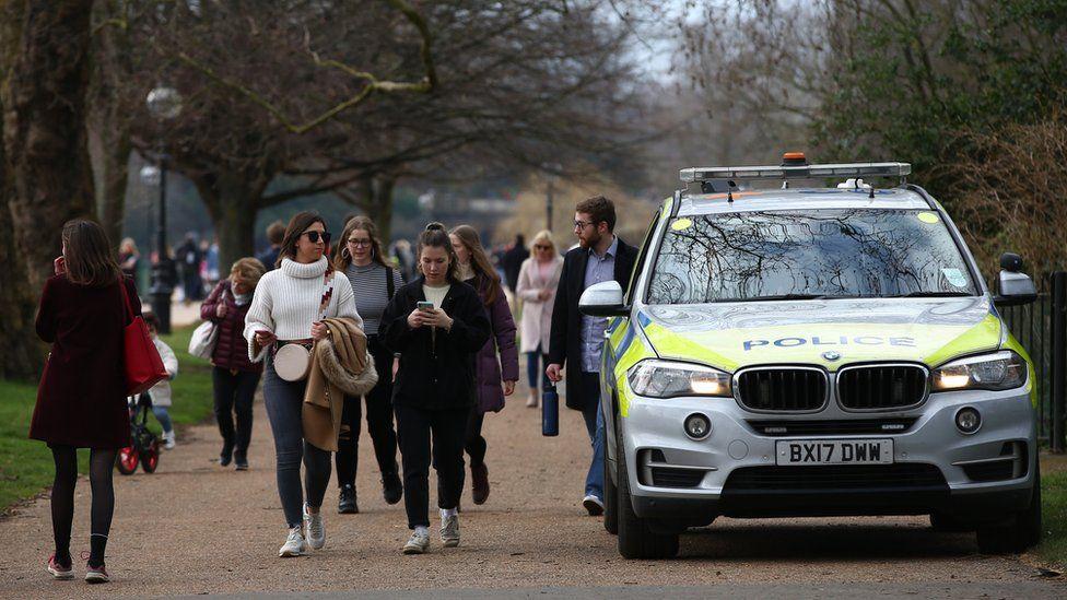 People walk in Hyde Park, London