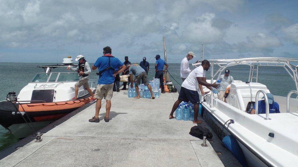 Unloading emergency supplies at Barbuda dock