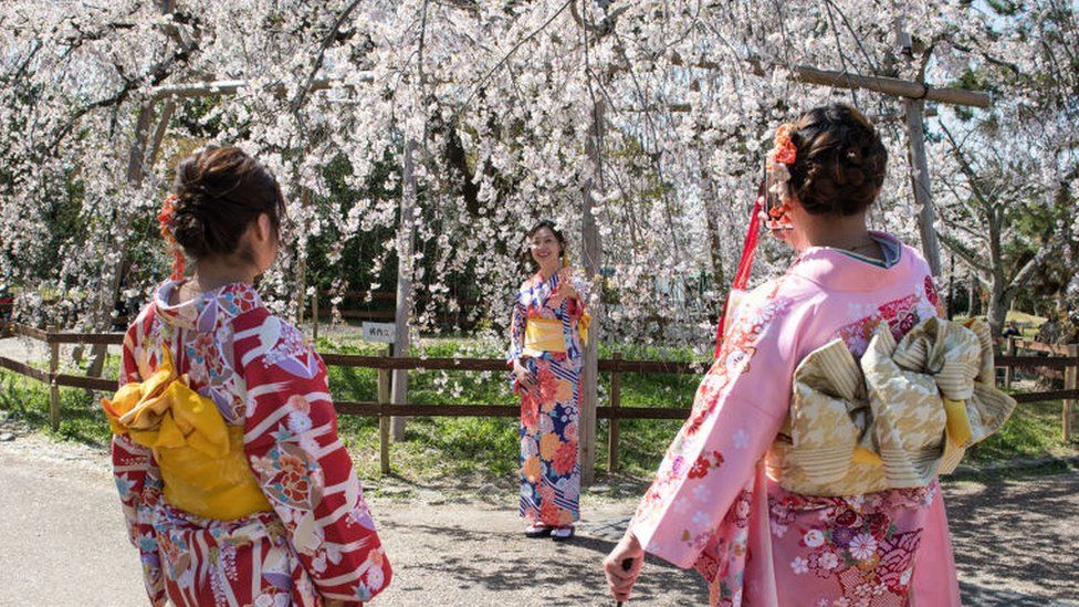 Women in Tokyo during cherry blossom season (file pic - 2018)