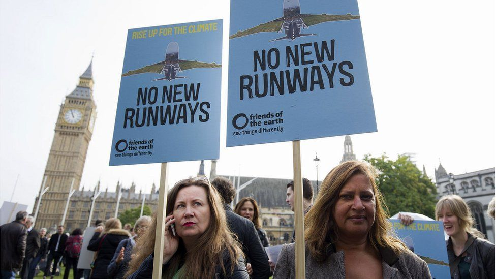 Protesters against a proposed expansion of Heathrow Airport gather at a rally in Parliament Square in London, 10 Oct 2015