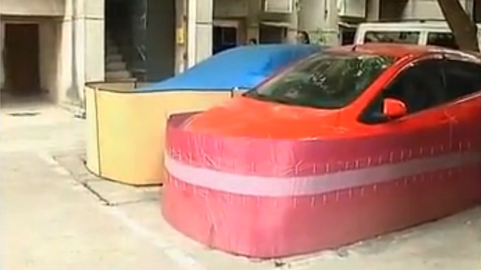 Two cars in Nanning with rat-proof shields