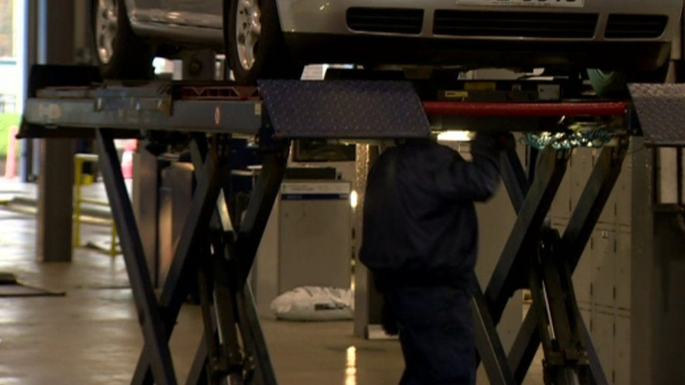 Scissor lifts are used in MOT centres to inspect underneath vehicles