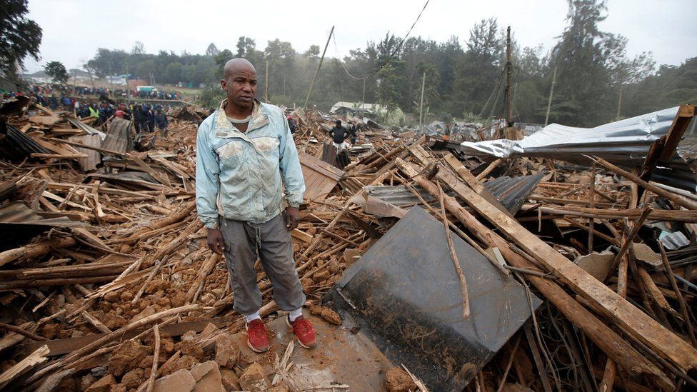 A man stands on the rubbles of his home after bulldozers demolished dozens of houses to make way for a new road in the Kibera slum in Nairobi, Kenya, July 23, 2018