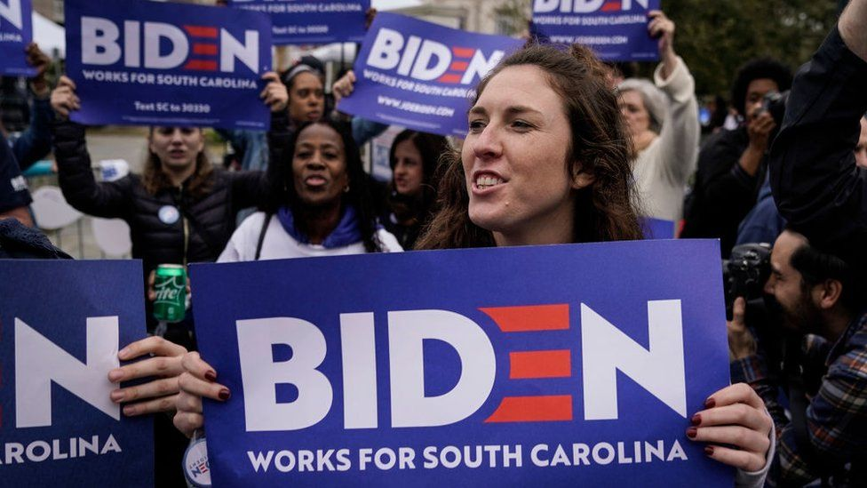 Voters in South Carolina hold signs supporting Joe Biden's presidential campaign