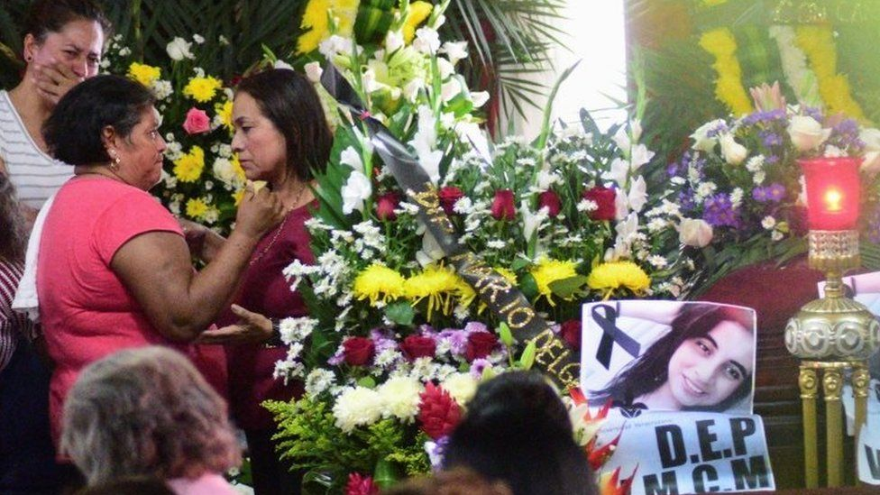 Friends try to console Carmen Medel at the wake of her daughter