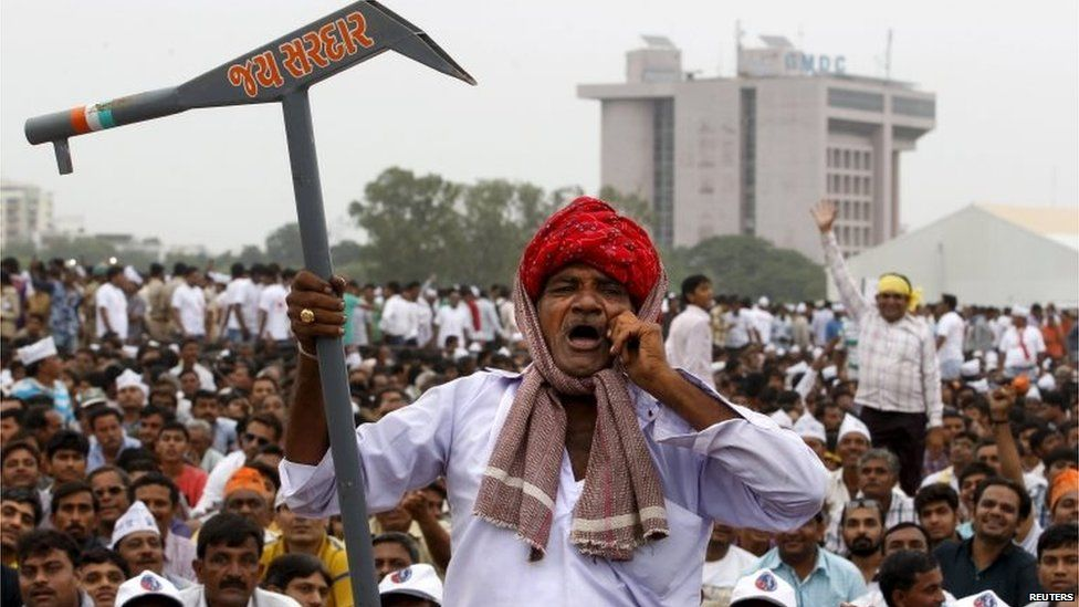 A member of the Patel community holding a mock scratch plough shouts slogans during a protest rally in Ahmedabad, India, August 25, 2015.