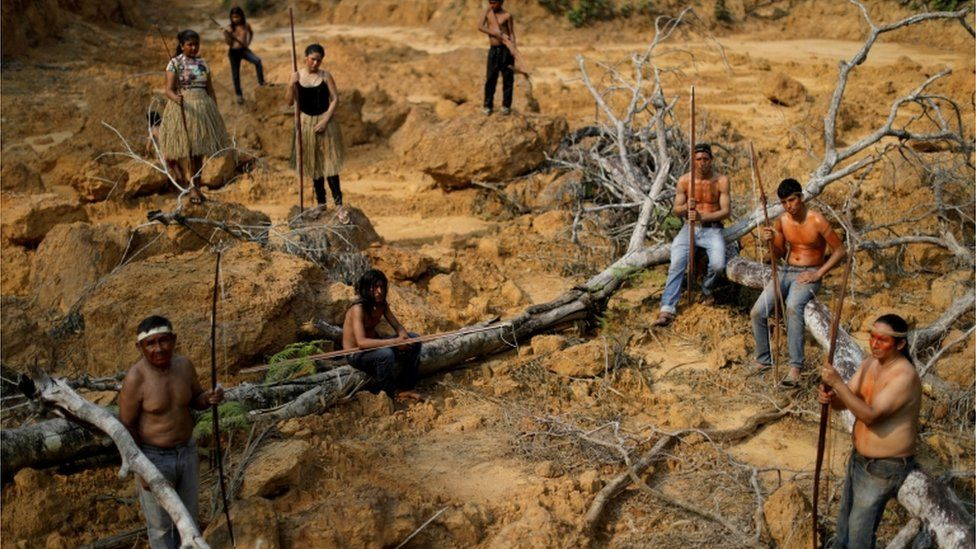 Indigenous people show a deforested area in unmarked indigenous lands inside the Amazon rainforest near Humaita, Amazonas State, Brazil August 20, 2019