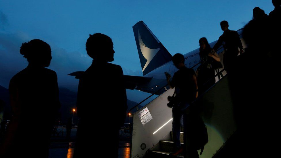 Guests descend from a Cathay Pacific Airways Airbus A350 after a tour of the aircraft cabin at Hong Kong Airport May 30, 2016.