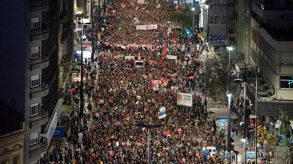 People march against a project that proposes security measures to be voted in a referendum during Sunday's general election, in Montevideo