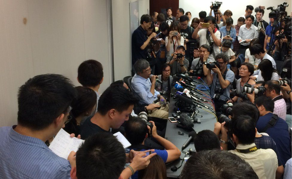 Formerly jailed publisher Lam Wing Kee surrounded by reporters at a press conference in Hong Kong - 16 June 2016