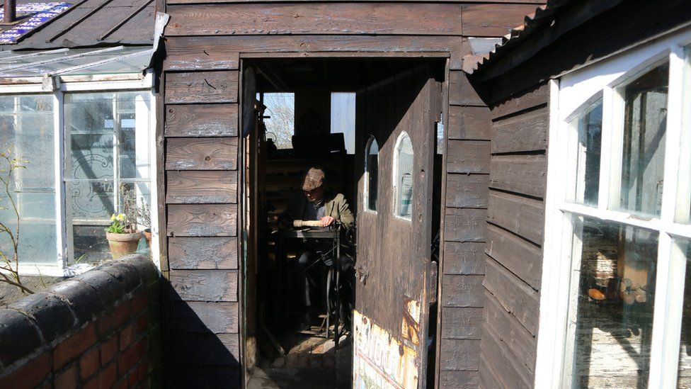 Man operating a lathe