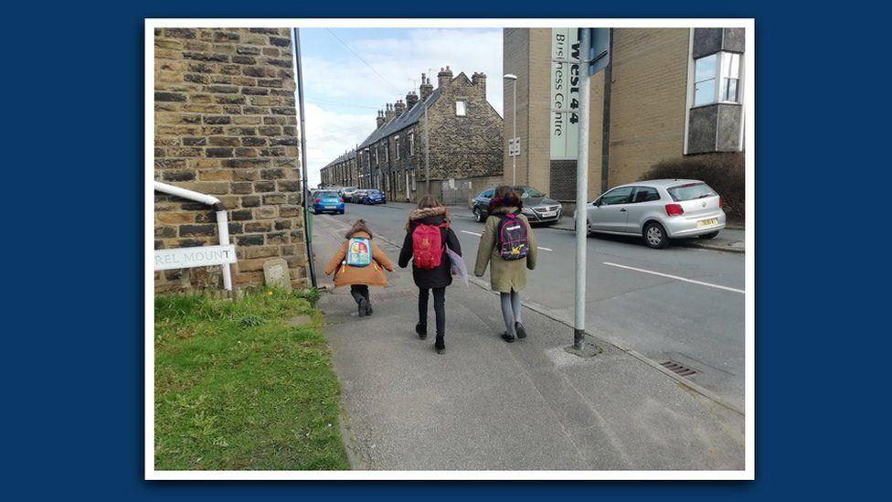 Emma's children and their friend walk home from school