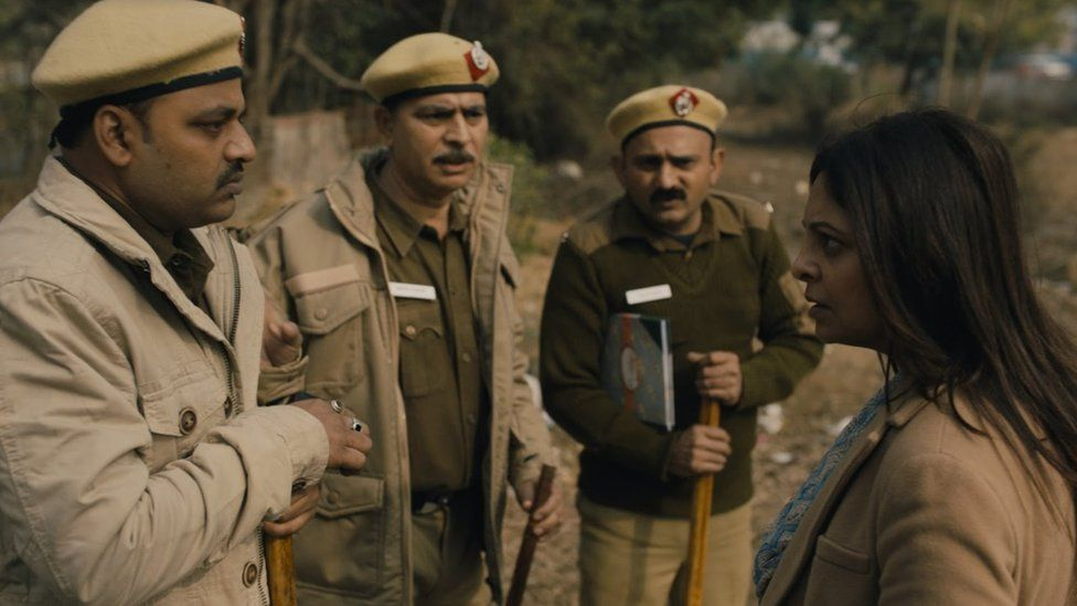A still from the series showing DCP Chaturvedi speak to three police officers