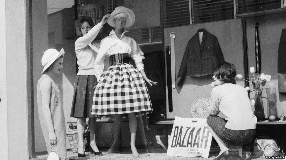 Women dressing a shop window in 1959