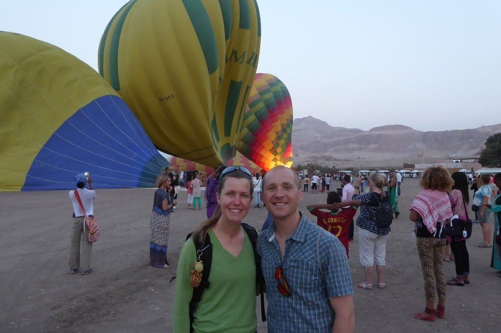 Dan and Esther in front of hot air balloons