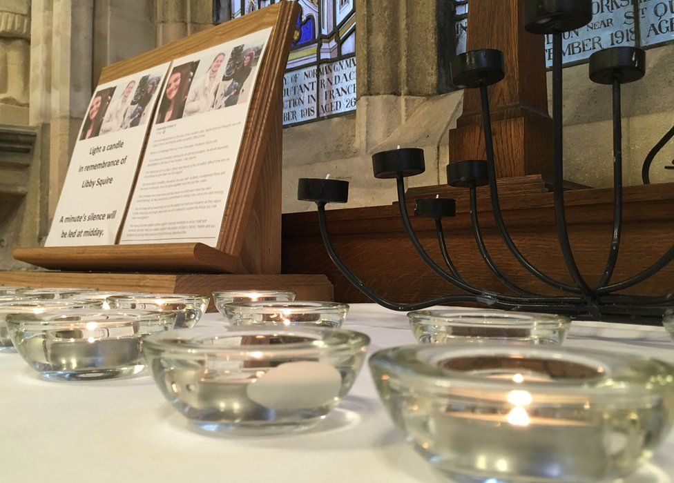 Candles underneath a Libby Squire memorial plaque