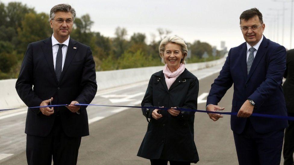 Ursula von der Leyen (C), Croatian Prime Minister Andrej Plenkovic (L) and Chairman of the Council of Ministers of Bosnia and Herzegovina, Zoran Tegletija (R) open a border crossing, a bridge over the Sava River between Croatia and Bosnia and Herzegovina