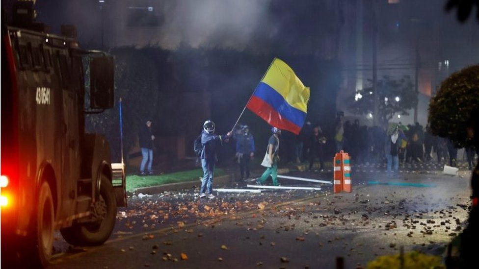 Members of the Mobile Anti-Riot Squad (ESMAD) confront protesters who arrive in the neighborhood where the President of Colombia Ivan Duque has his residence, during a day of protests against the tax reform, in Bogota, Colombia, 01 May 2021.