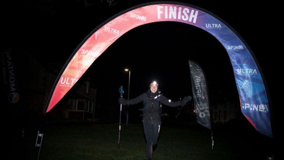 Jasmin Paris crossing the finish line
