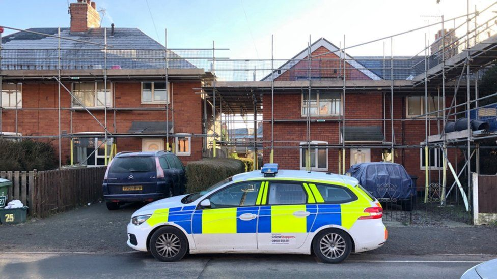 A woman was pronounced dead at the house in Ruabon and a murder investigation has been launched