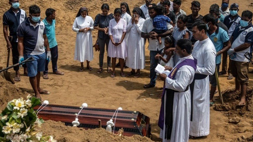Mourners attend the funeral of a person killed in the Easter Sunday attack in Negombo