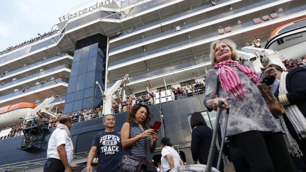 Passengers leaving the Westerdam