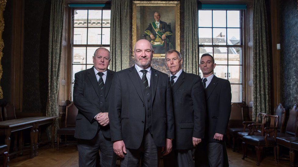 Left to right: David Begg, Grand Secretary of the Grand Lodge of Scotland, Ewan Rutherford, Depute Grand Master, Ramsay McGhee, Depute Grand Master at time of filming, Clark Wilson, Grand Tyler