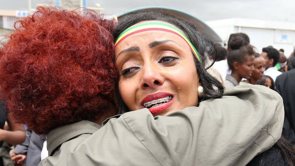 Relatives embrace after meeting at Asmara International Airport, after one arrived aboard the Ethiopian Airlines ET314 flight in Asmara, Eritrea July 18, 2018.