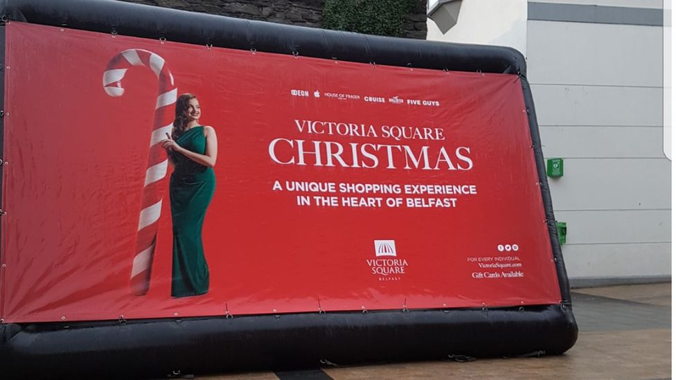 Large advertisement for Victoria Square in Waterloo Place in Derry
