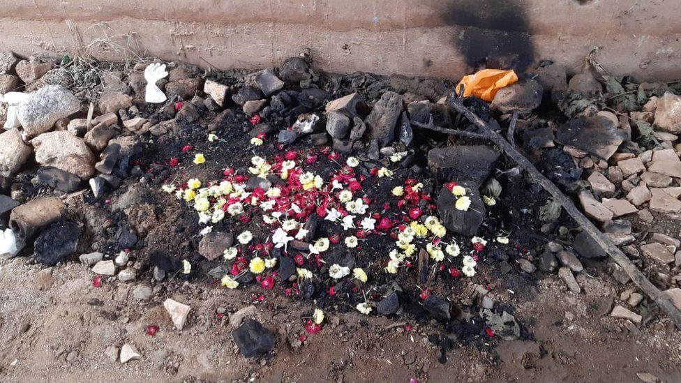 Flower petals where the vet's charred body was found