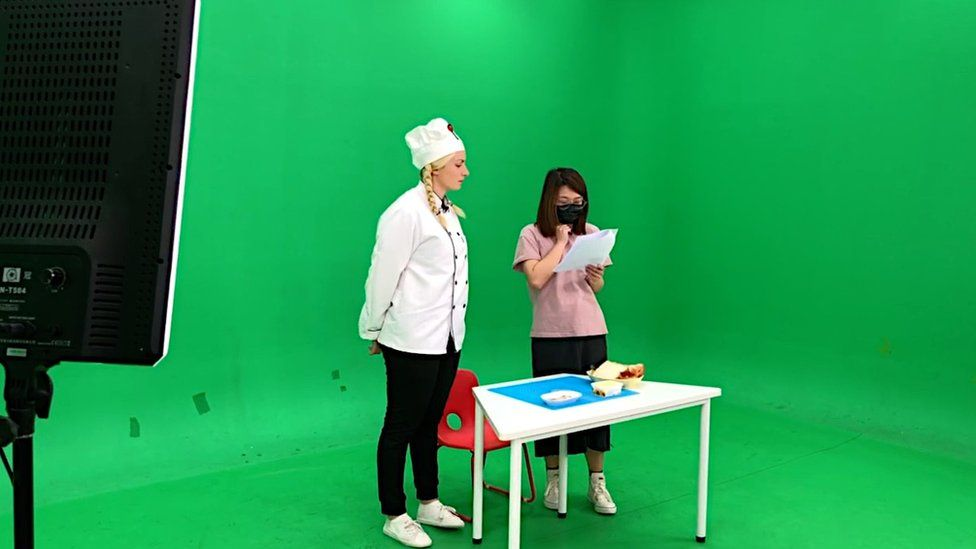 Jen Smith filming a TV show in front of a green screen