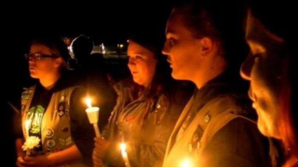 Fellow Girl Scouts sang at a vigil held for the victims on Sunday