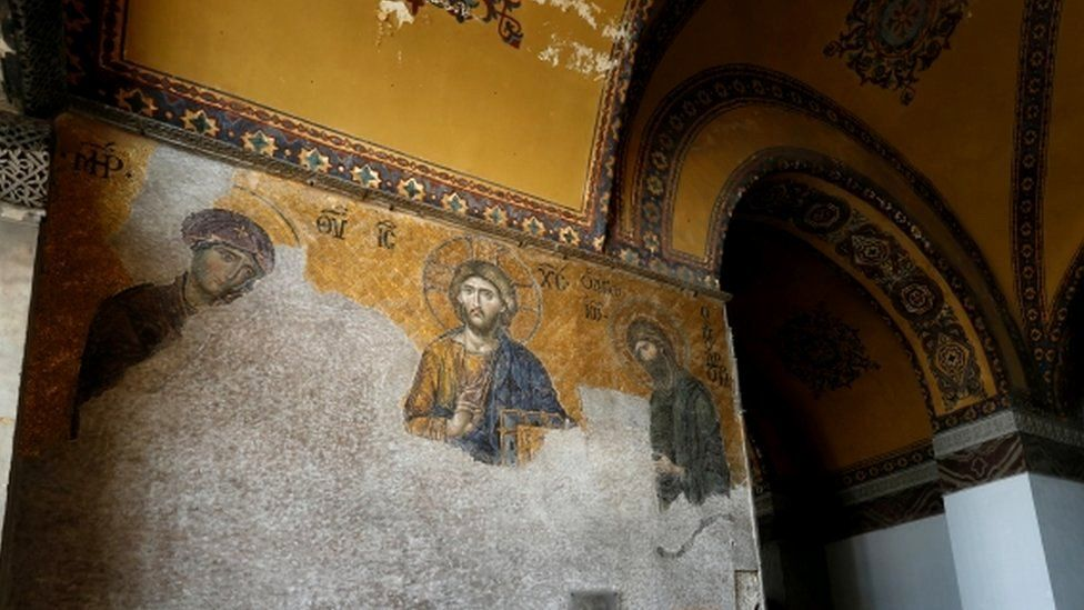 Visitors look at mosaics at Hagia Sophia, August 2017