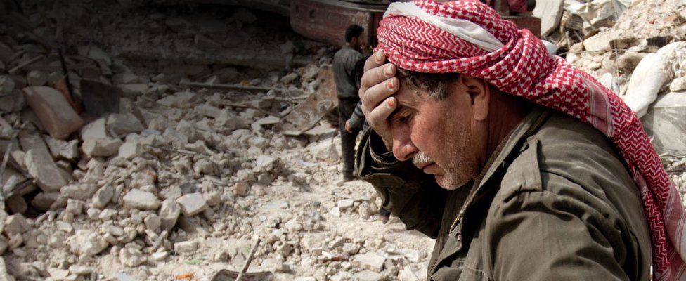 Grieving Syrian man