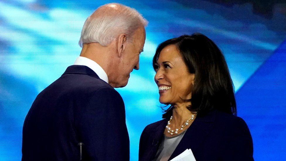 Former Vice-President Joe Biden talks with Senator Harris after the conclusion of the 2020 Democratic US presidential debate in Houston, Texas, 12 September 2019