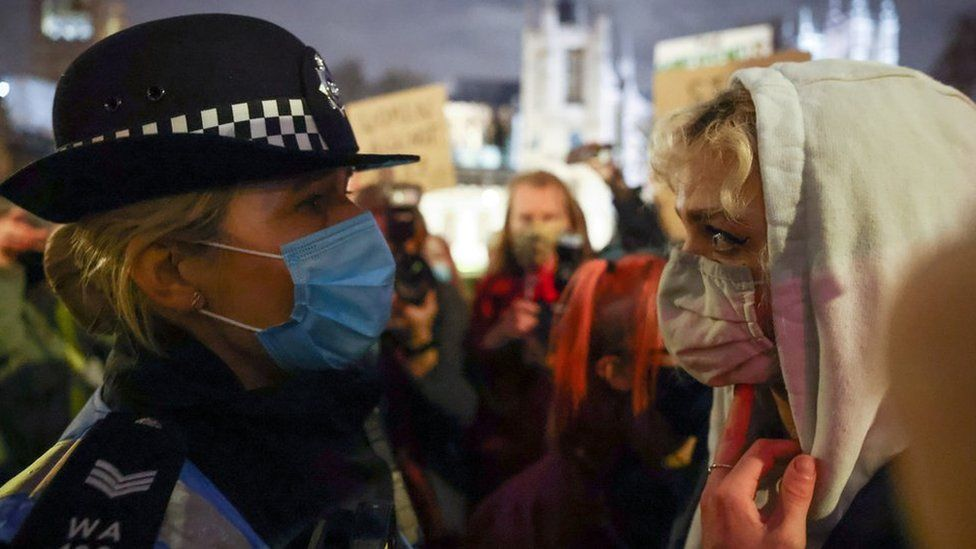 A police woman with a protester