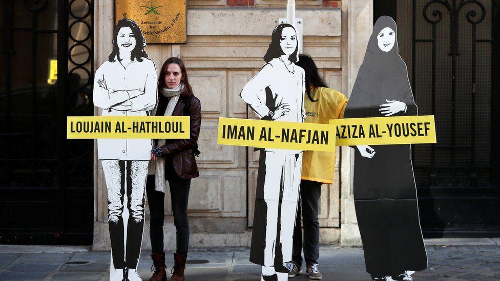 Amnesty International urges Saudi authorities to release activists Loujain al-Hathloul, Eman al-Nafjan and Aziza al-Yousef, outside the Saudi Arabian embassy in Paris, March 8, 2019